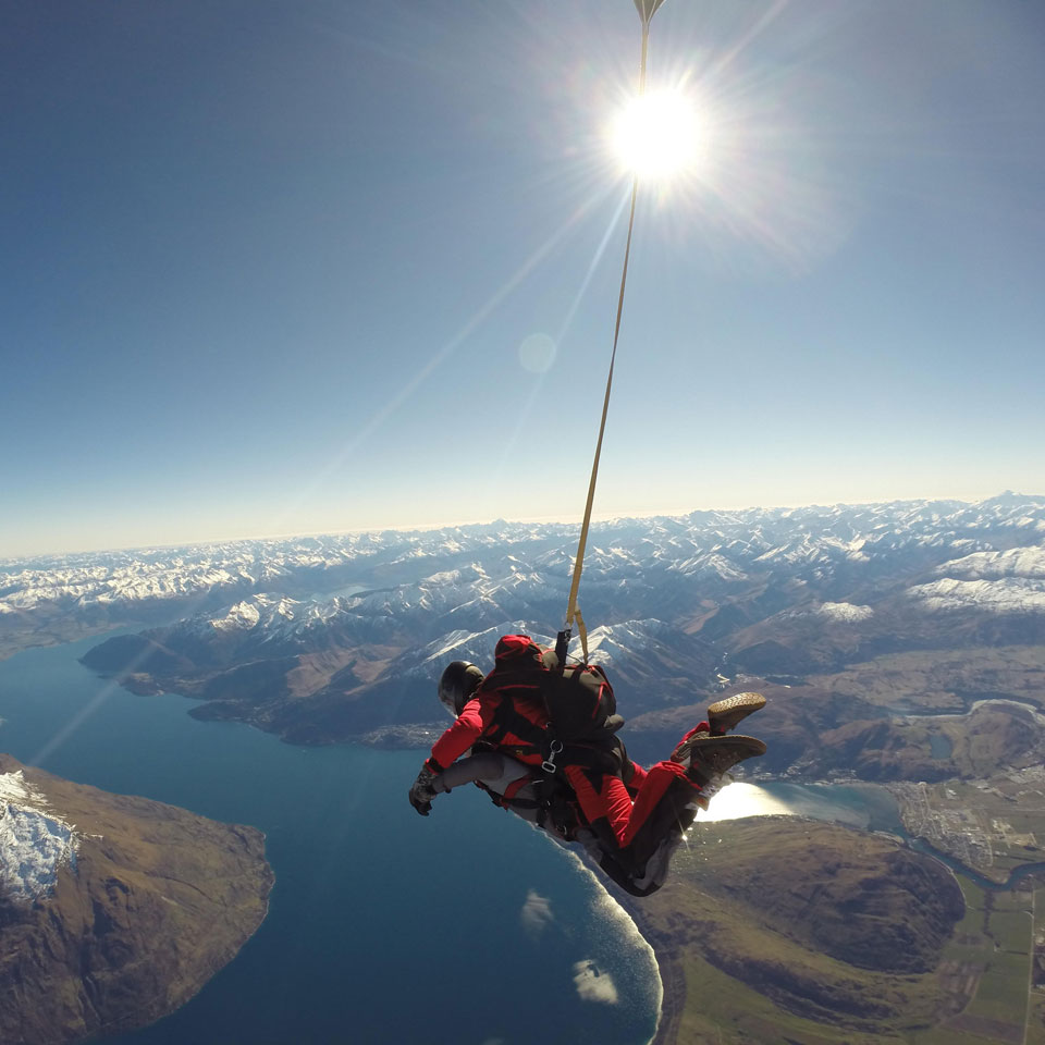 Photo credit (NZONE Skydive). Location displayed (Queenstown).
