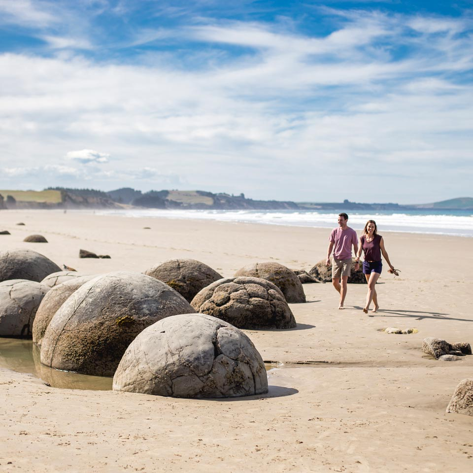 Photo credit (Miles Holden). Location displayed (Moeraki Boulders, Otago).