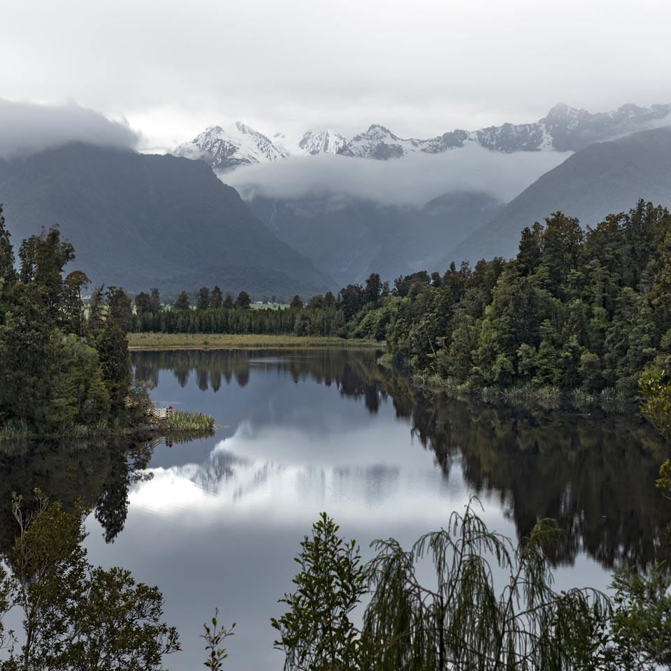 Photo credit (Miles Holden). Location displayed (Lake Matheson, West Coast).