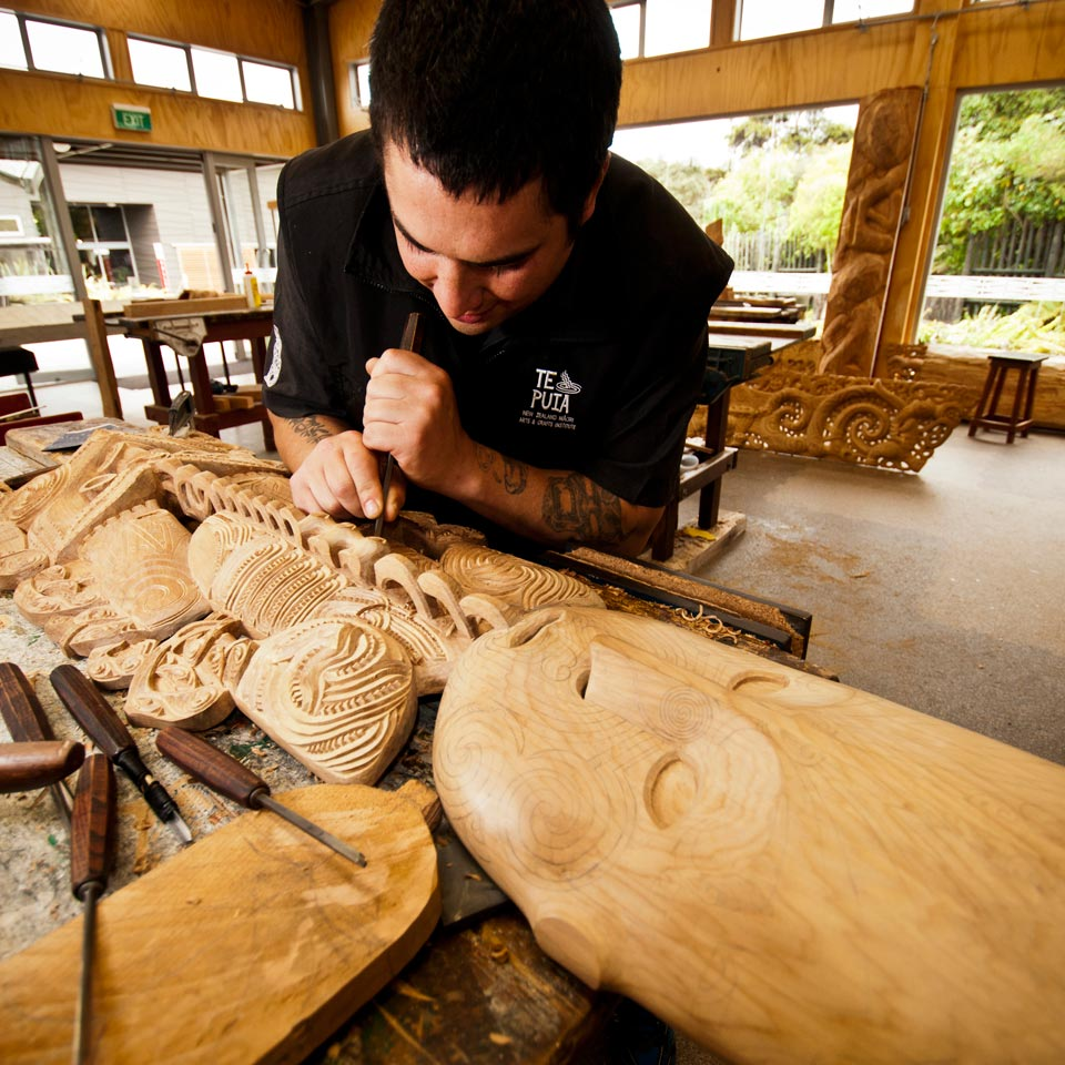 Photo credit (Eric Lindberg). Location displayed (Te Puia, National Carving School, Rotorua).