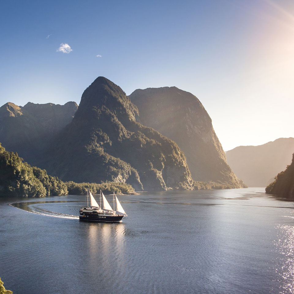 Photo credit (Real Journeys). Location displayed (Doubtful Sound, Fiordland).