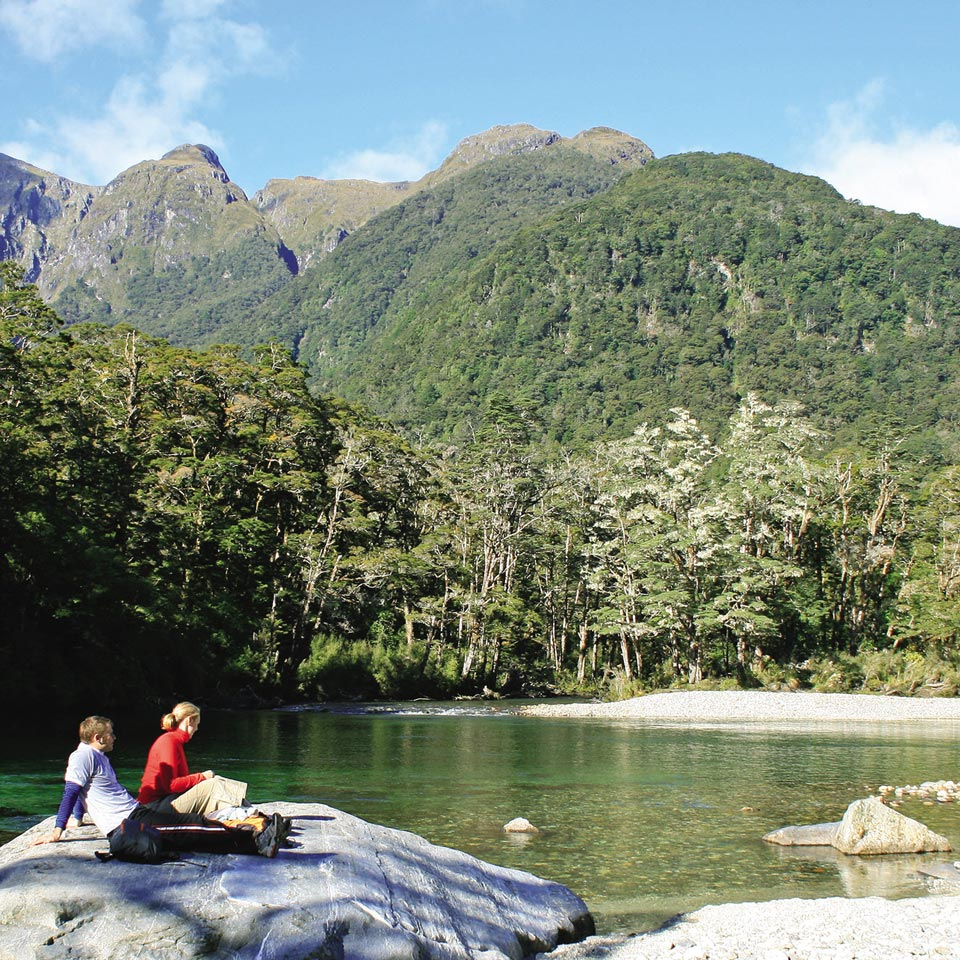 Photo credit (Real Journeys). Location displayed (Milford Track, Fiordland).